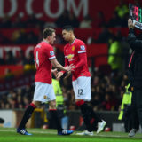 MANCHESTER, ENGLAND - FEBRUARY 11: Chris Smalling of Manchester United comes on for Phil Jones of Manchester United during the Barclays Premier League match between Manchester United and Burnley at Old Trafford on February 11, 2015 in Manchester, England.  (Photo by Jamie McDonald/Getty Images)