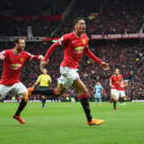 MANCHESTER, ENGLAND - APRIL 12:  Chris Smalling of Manchester United with celebrates with Juan Mataas he scores their fourth goal during the Barclays Premier League match between Manchester United and Manchester City at Old Trafford on April 12, 2015 in Manchester, England.  (Photo by Michael Regan/Getty Images)
