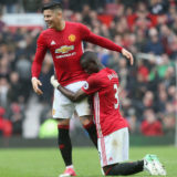 MANCHESTER, ENGLAND - APRIL 16:  Marcos Rojo and Eric Bailly of Manchester United celebrate after the Premier League match between Manchester United and Chelsea at Old Trafford on April 16, 2017 in Manchester, England.  (Photo by Tom Purslow/Manchester United via Getty Images)