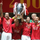 MOSCOW, RUSSIA - MAY 21:  Carlos Tevez, Rio Ferdinand, Wes Brown, Ryan Giggs and Mikael Silvestre of Manchester United celebrate with the trophy after winning the UEFA Champions League Final match between Manchester United and Chelsea at Luzhniki Stadium on May 21 2008 in Moscow, Russia. (Photo by Matthew Peters/Manchester United via Getty Images)