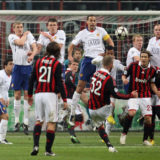 MILAN, ITALY - FEBRUARY 16: David Beckham of AC Milan takes a free-kick during the UEFA Champions League First Knock-Out Round match between AC Milan and Manchester United at the San Siro Stadium on February 16 2010 in Milan, Italy. (Photo by John Peters/Manchester United via Getty Images)