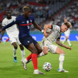 MUNICH, GERMANY - JUNE 15: Paul Pogba of France battles for possession with Toni Kroos of Germany during the UEFA Euro 2020 Championship Group F match between France and Germany at Football Arena Munich on June 15, 2021 in Munich, Germany. (Photo by Matthias Hangst/Getty Images)