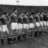 The players of Manchester United FC line up on the pitch at Belgrade before their European Cup quarter final match against Yugoslav side, Red Star Belgrade. The match resulted in a 3-3 draw that qualified united for the semi finals. The journey home, however, proved ill fated, resulting in the Munich plane crashed that killed many of the 'Busby Babes'.   (Photo by Keystone/Getty Images)