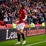 MANCHESTER, ENGLAND - MAY 18:   Edinson Cavani of Manchester United celebrates scoring a goal to make the score 1-0 during the Premier League match between Manchester United and Fulham at Old Trafford on May 18, 2021 in Manchester, United Kingdom. (Photo by Ash Donelon/Manchester United via Getty Images)
