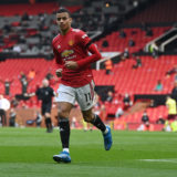 MANCHESTER, ENGLAND - APRIL 18: Mason Greenwood of Manchester United celebrates after scoring his team's first goal during the Premier League match between Manchester United and Burnley at Old Trafford on April 18, 2021 in Manchester, England. Sporting stadiums around the UK remain under strict restrictions due to the Coronavirus Pandemic as Government social distancing laws prohibit fans inside venues resulting in games being played behind closed doors. (Photo by Gareth Copley/Getty Images)