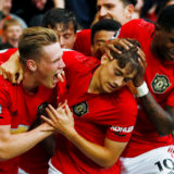"""Soccer Football - Premier League - Manchester United v Chelsea - Old Trafford, Manchester, Britain - August 11, 2019  Manchester United's Daniel James celebrates scoring their fourth goal with Scott McTominay, Marcus Rashford and team mates  Action Images via Reuters/Jason Cairnduff  EDITORIAL USE ONLY. No use with unauthorized audio, video, data, fixture lists, club/league logos or """"live"""" services. Online in-match use limited to 75 images, no video emulation. No use in betting, games or single club/league/player publications.  Please contact your account representative for further details."""
