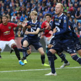 OSLO, NORWAY - JULY 30: Marcos Rojo of Manchester United in action with Noah Solskjaer of Kristiansund BK during the Pre-Season Friendly match between Kristiansund BK and Manchester United at Ullevaal Stadion on July 30, 2019 in Oslo, Norway. (Photo by Matthew Peters/Manchester United via Getty Images)