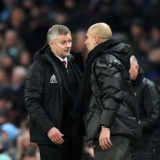 MANCHESTER, ENGLAND - DECEMBER 07: Ole Gunnar Solskjaer, Manager of Manchester United speaks with Pep Guardiola, Manager of Manchester City during the Premier League match between Manchester City and Manchester United at Etihad Stadium on December 07, 2019 in Manchester, United Kingdom. (Photo by Michael Regan/Getty Images)