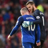 Manchester United's Spanish goalkeeper David de Gea (R) chats with Everton's English striker Wayne Rooney as they walk off the pitch at half time during the English Premier League football match between Manchester United and Everton at Old Trafford in Manchester, north west England, on September 17, 2017. / AFP PHOTO / Oli SCARFF / RESTRICTED TO EDITORIAL USE. No use with unauthorized audio, video, data, fixture lists, club/league logos or 'live' services. Online in-match use limited to 75 images, no video emulation. No use in betting, games or single club/league/player publications.  / OLI SCARFF/AFP/Getty Images