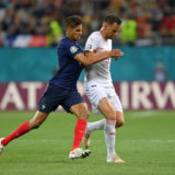 BUCHAREST, ROMANIA - JUNE 28: Haris Seferovic of Switzerland battles for possession with Raphael Varane of France during the UEFA Euro 2020 Championship Round of 16 match between France and Switzerland at National Arena on June 28, 2021 in Bucharest, Romania. (Photo by Justin Setterfield/Getty Images)
