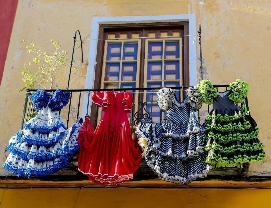 Traditional flamenco dresses at a house in Malaga, Andalusia | Spain Travel Guide