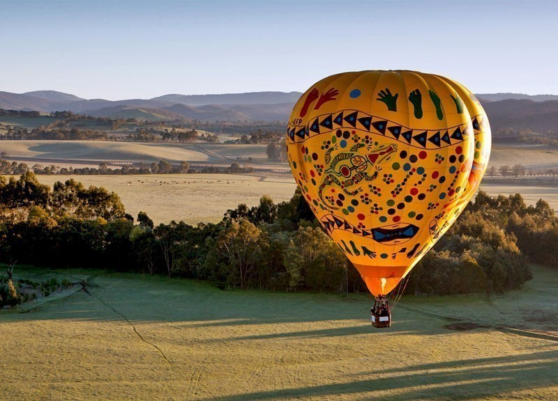 A sunrise hot air balloon flight over the Yarra Valley in Victoria, Australia | 10 Best Hot Air Balloon Rides Around The World