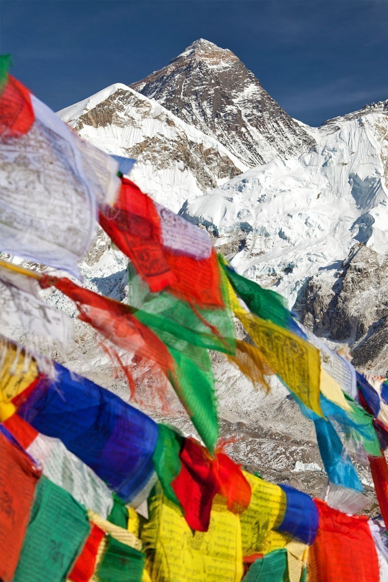 View of Mount Everest with buddhist prayer flags from Kala Patthar, Nepal   TOP 10 Places To Travel in May