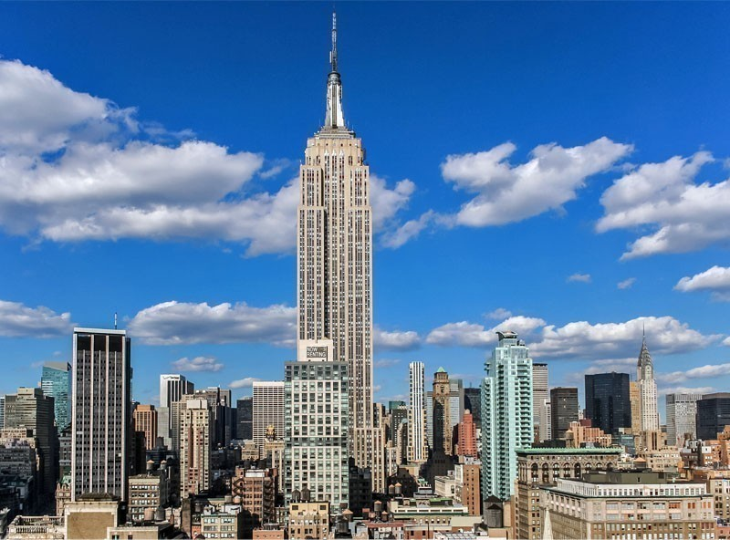 View over the Empire State Building from a roof top in New York City | TOP 10 Tourist Attractions in New York City