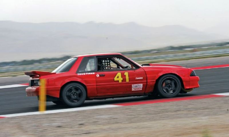 Fox Body Mustang on the track.