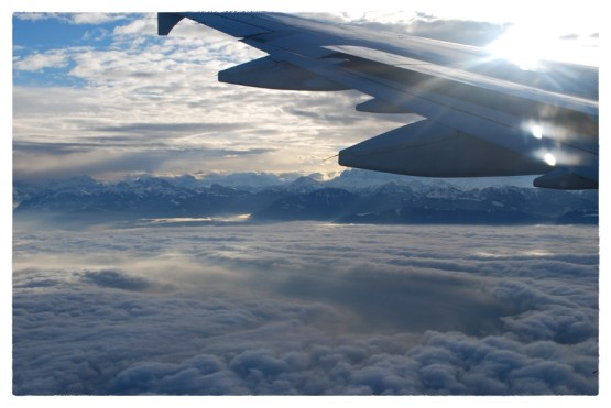 The Swiss Alps peek up from the clouds