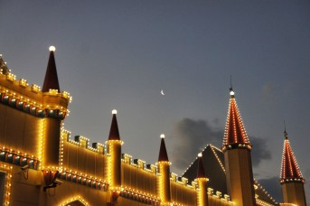 Crescent moon hangs above The Crystal Palace