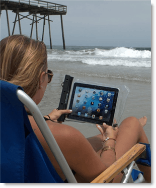 Woman with Tablet On Beach