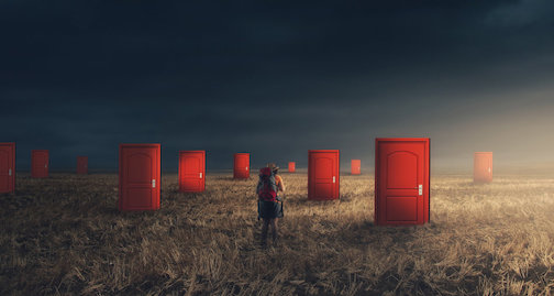 Traveler with a backpack on field with multiple doors . Hard choices concept . Difficult decision and ways to unknown future.