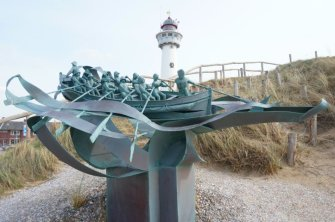 Statue of the coastgard near the Lighthouse of Egmond.