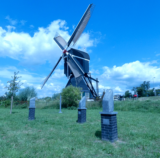 Cycling holidays in Holland crossing the major rivers. Leerdam windmill