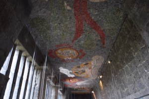 One of the murals made of small-multicolor-stones adorning the ceilings of the Anahuacalli Museum .