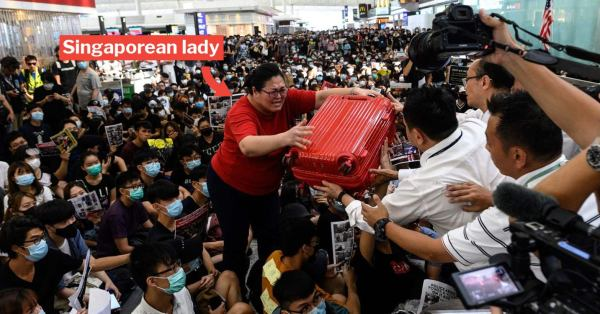 Woman Lifting Red Suitcase In Viral Hong Kong Airport Protest Pictures Is A S'porean Returning Home