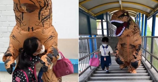 S'pore Boy Dons T-Rex Costume To Fetch Sister From School, Holds Her Hand Protectively