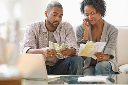 Couple computer finances money