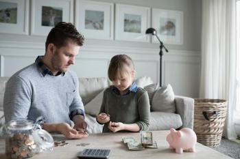 father and daughter counting change
