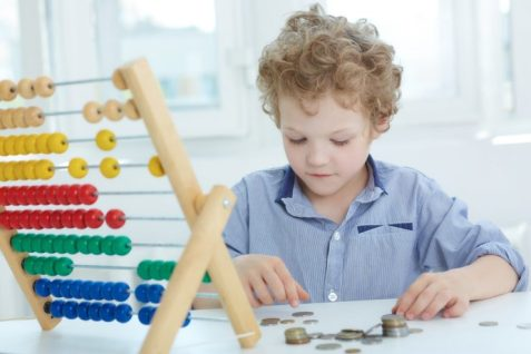 young boy child with Abacus