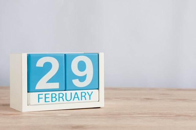February 29th. Cube calendar for february 29 on wooden surface with empty space For text. Leap year, intercalary day