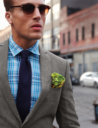 Gray jacket with green paisley square.