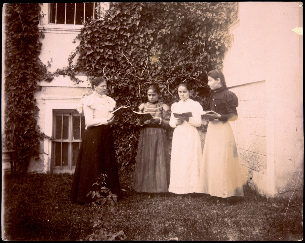 Principal Harriet Cole teaches an English literature course outside of the American School building. Students shown are members of the American School's Class of 1900