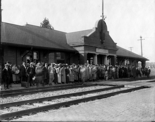 photo of People Awaiting Train