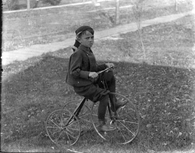 photo of Unidentified Boy Riding Tricycle
