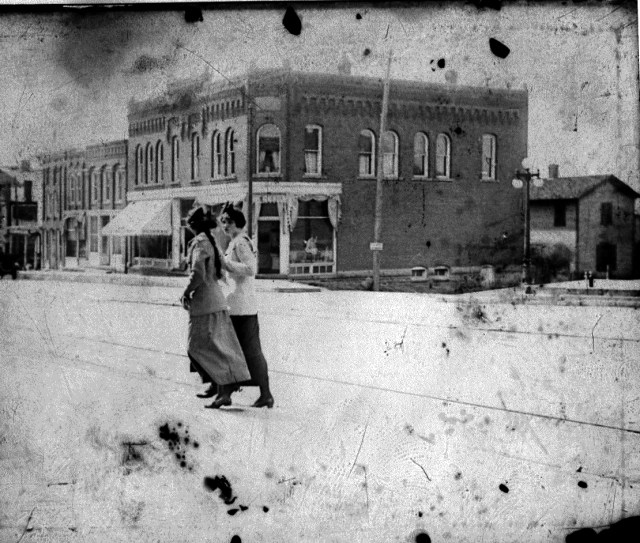photo of Women Walking Downtown