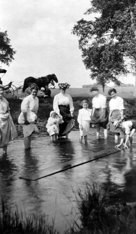 photo of Unidentified Women and Children Wading in a Stream
