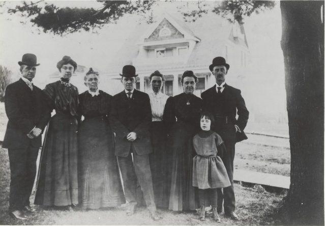 Photo of Keyes family standing next to big pine tree