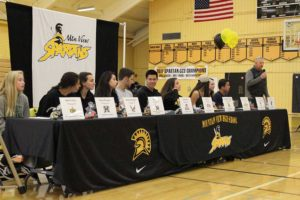 Student athletes commit to NCAA schools on National Signing Day