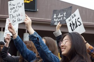 Students at the walkout held signs that advocated for gun control or expressed anti-Trump sentiment. Photo by Hallie Olson.