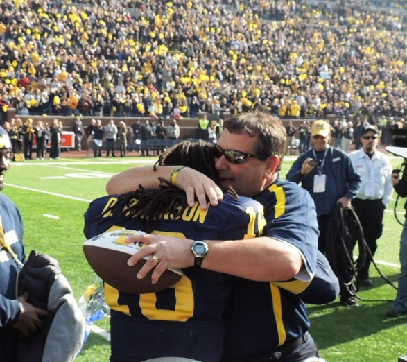 Brady Hoke hugs Denard Robinson - MVictors.com