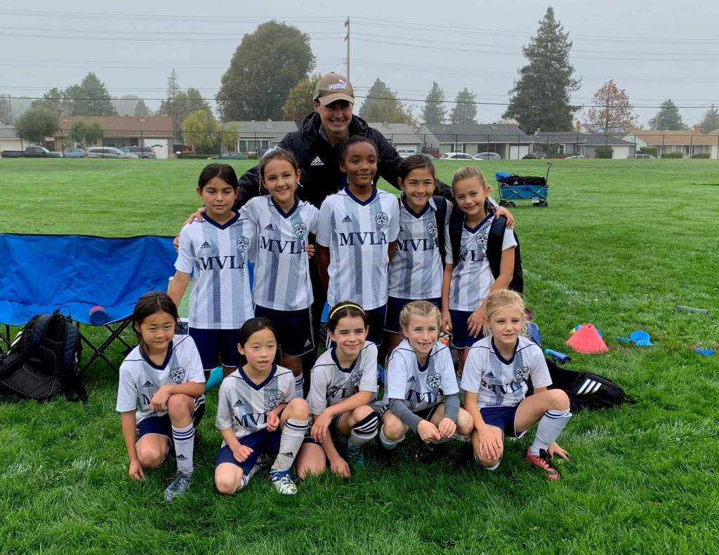 11G Madrid Blue and Coach John for finishing first in their NorCal Gold league