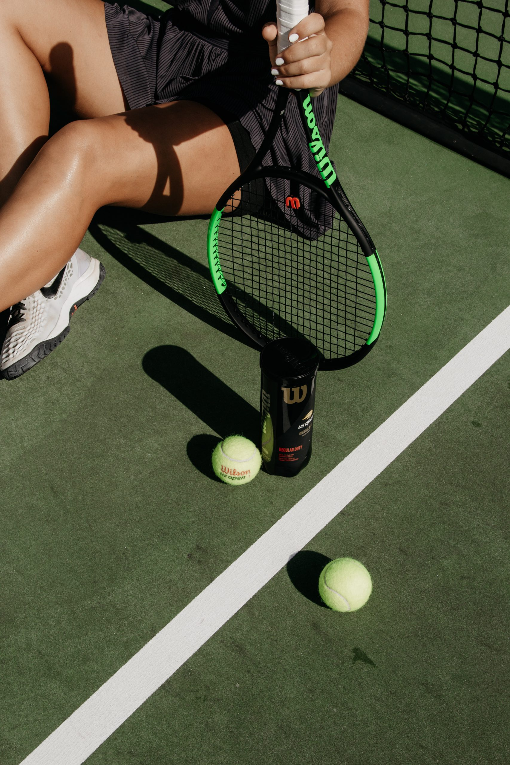 green-tennis-balls-and-black-racket-2996254