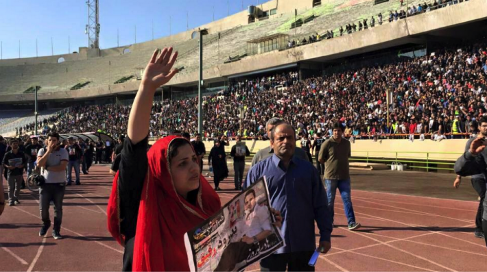"""The wife of the Iranian football player, Hadi Nouroozi, said goodbye to her beloved husband today in the football stadium today. When she entered the stadium she said: """"Finally I came here, I wish I didn't"""". Women in Iran are banned from stadium to watch the men's game."""