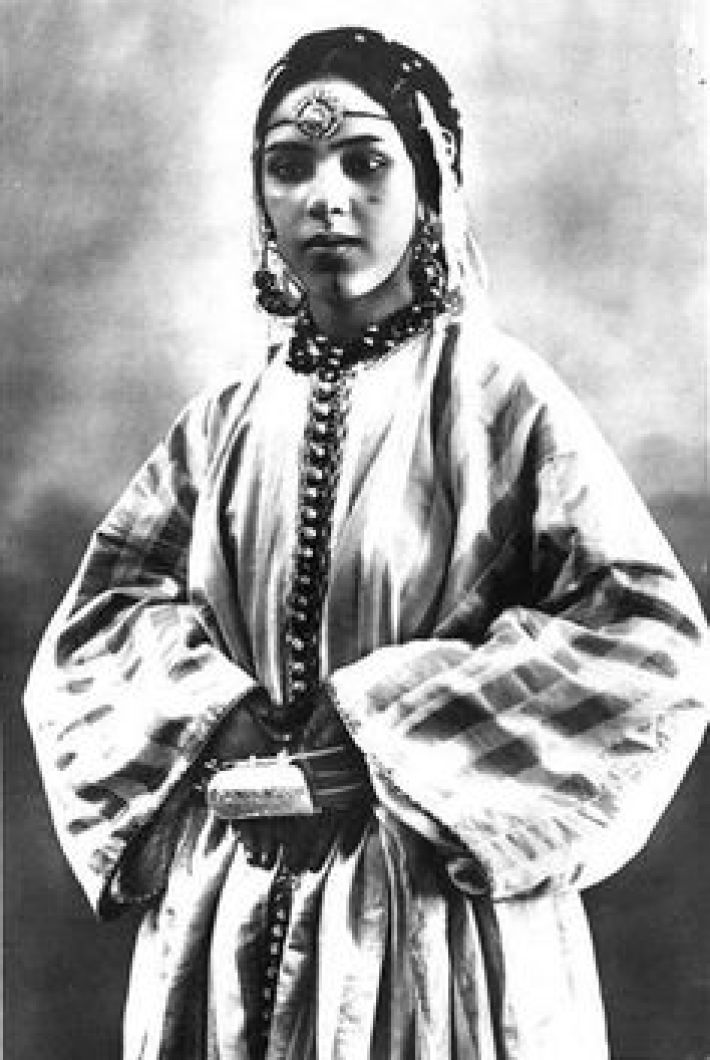 modest fashion - A young woman pictured modeling a traditional Moroccan kaftan