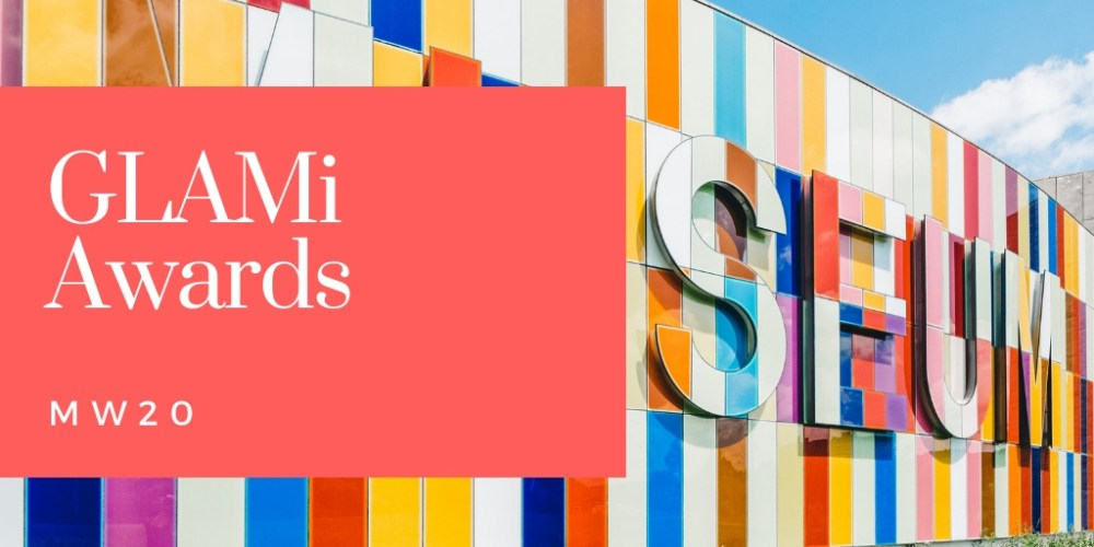 A colorful building with mosaic-like design and a red box with the words, GLAMi AWARDS MW20.