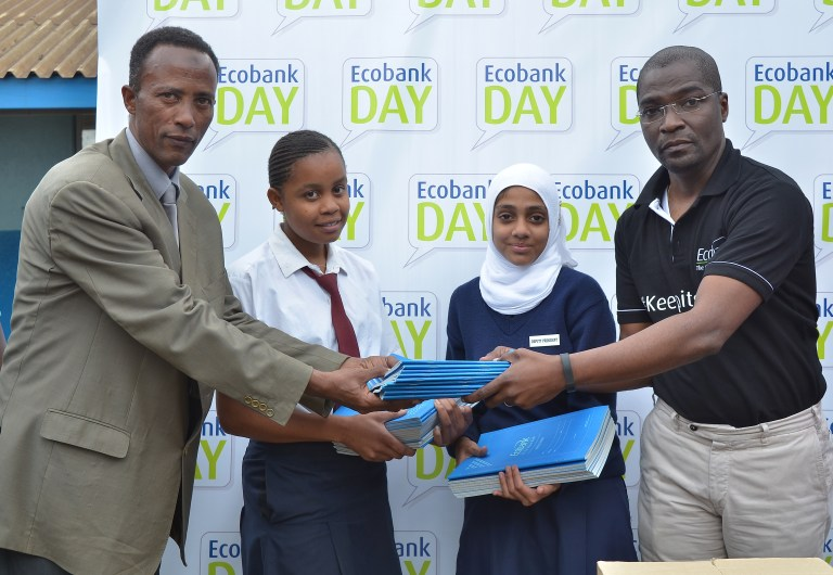 Ecobank Kenya out-going Managing Director Ehouman Kassi (right) donates exercise books to the students and Principal of County Girls High School Mr. Mude Mude (left) as part of an initiate to support education in the country.