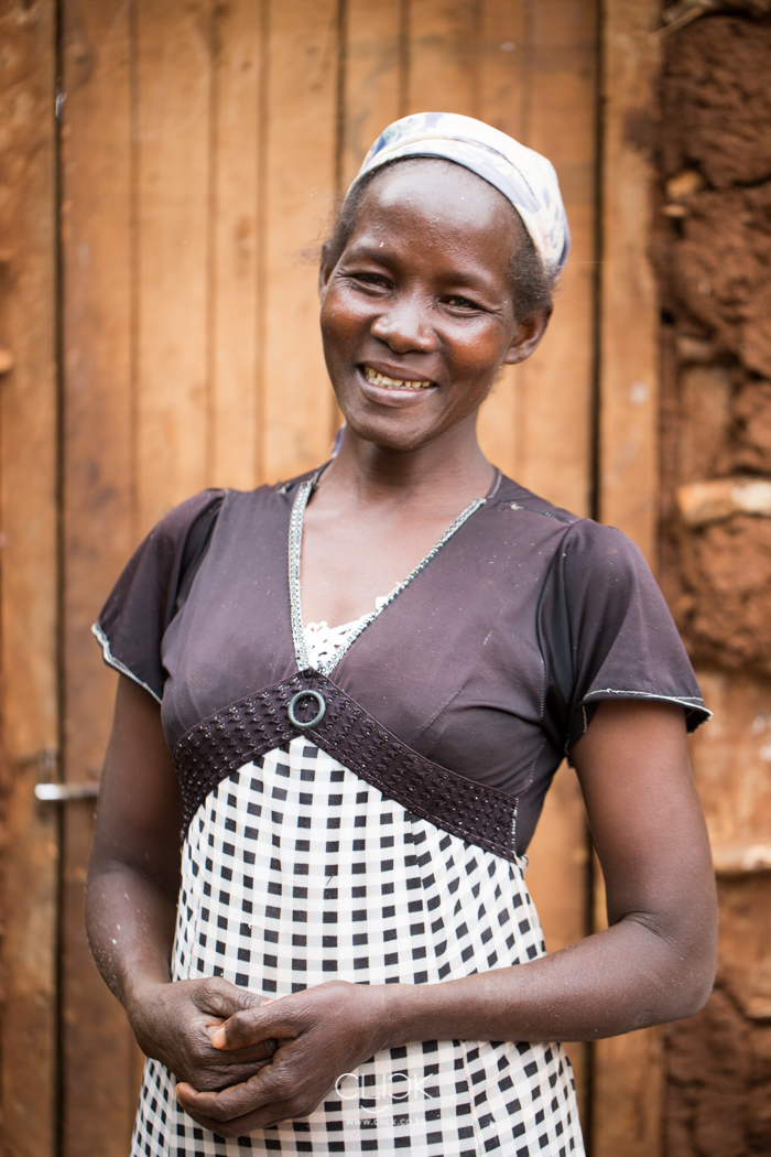 Mary Gachoka Simon, 42, at her home in Tharaka North Sub County, Kenya, on 19th July 2016. Mary has been farming for 10 years and grows green grams, sorghum and millet as well. She delivers her produce to Mukothima Grain Aggregation Centre which was set up with the help of Agra. By uniting with other farmers and selling in bulk, Mary has been able to educate her children, buy clothes and food for her family of 4.