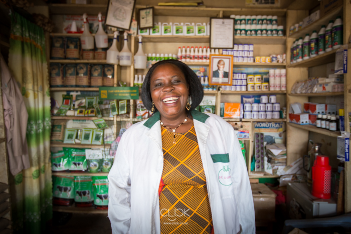 Ann Munala in her agro supplies outlet in Luanda Market, Kenya, on 21st July 2016. Being one of the leading stockists of lime based fertiliser in the region, Ann has helped educate farmers on the benefits of planting in nutrient-rich soils. This after she received training on the same from Kenya Agricultural and Livestock Research Organisation in partnership with Agra. Ann testifies that she has seen farmers grow their harvest exponentially through the lessons she's shared with them.